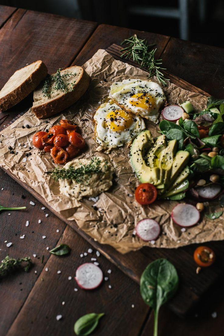 Sunny Side Up eggs w homemade hummus, grilled & caramalized tomatoes, avocado and salad salad salad @roamersberlin