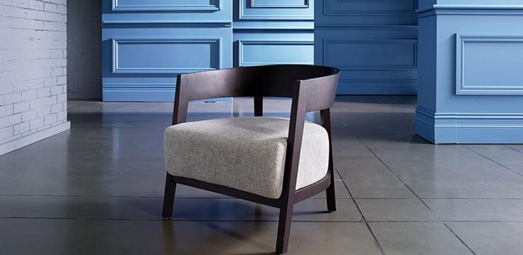 Fabric cushioned armchair with timber frame.