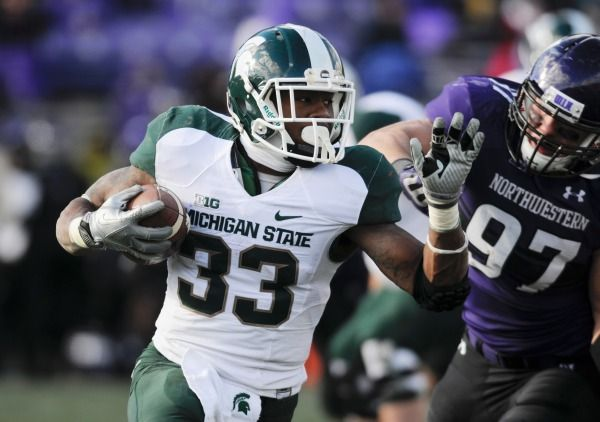 Jeremy Langford (33) rushes the ball during the second half against the Northwestern Wildcats at Ryan Field. Michigan State won 30-6. Mandatory Credit: Reid Compton-USA TODAY Sports