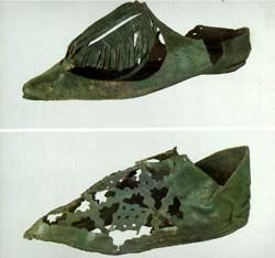 Leather shoes with cut-out ornament. 14th century. Novgorod, Kremlin, Russia - the archaeological collection of the museum contains materials from archaeological monuments of the Novgorod region beginning from the late Stone Age up until the late Middle Ages (140,000 items). But the essence of the collection are the materials gathered during archaeological studies of the Novgorod sites. They have been carried out here on a regular basis since 1932.