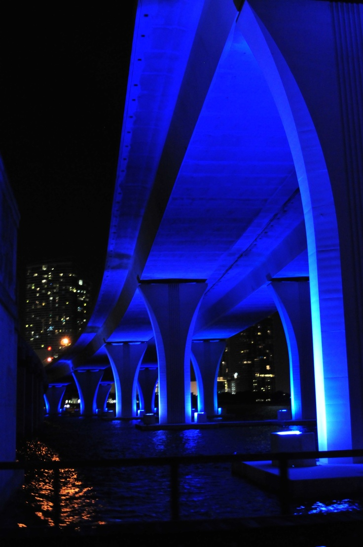 This awesome bridge all lit up in neon blue is the prettiest bridge I have ever seen. It passes American Airlines Arena where the world champion NBA Miami Heat play & ascends the approach of the Port Boulevard Bridge over Biscayne Bay. On the other side of the bridge, SR 886 ends at the entrance to the Port of Miami. The Port of Miami is  where all the cruise ships dock & set sail from.