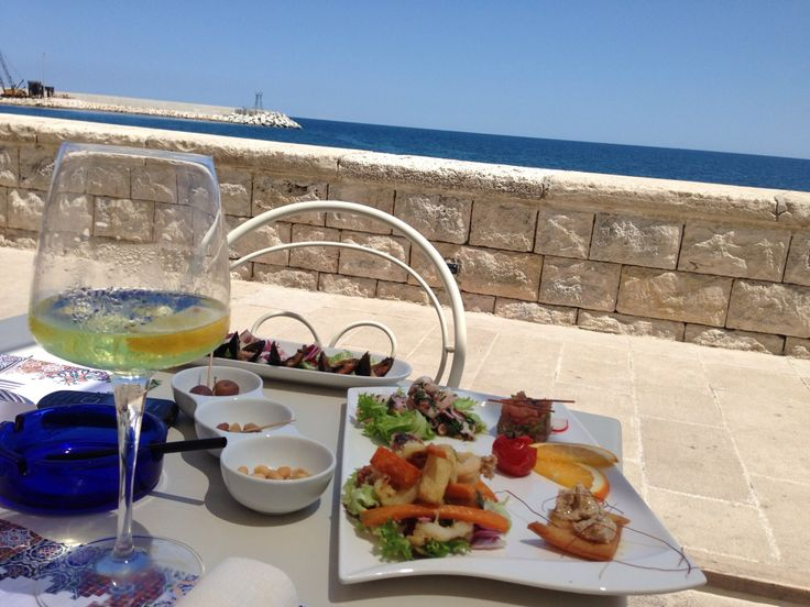 Aperitivo on the coast! A must of Monopoli's culture. Often bigger than a lunch, that's the Pugliese way of enjoy fresh sea food and cheses with dry white vine or Prosecco!
