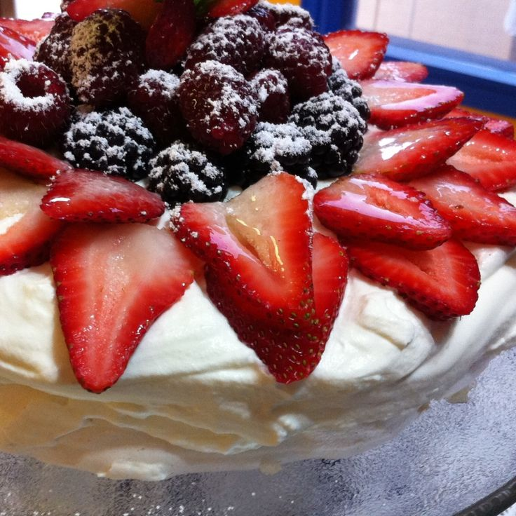 An easy pavlova recipe that is so light and delicious. Topped with fresh juicy berries, this dessert will have the whole table wishing you made double.