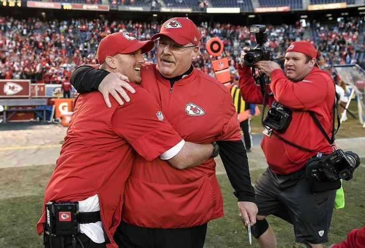 Kansas City Chiefs head coach Andy Reid, center, hugged his son and assistant defensive line coach, Britt Reid, following the 37-27 win over the San Diego Chargers on January 1, 2017 at Qualcomm Stadium in San Diego. The Chiefs won the AFC West with the win.