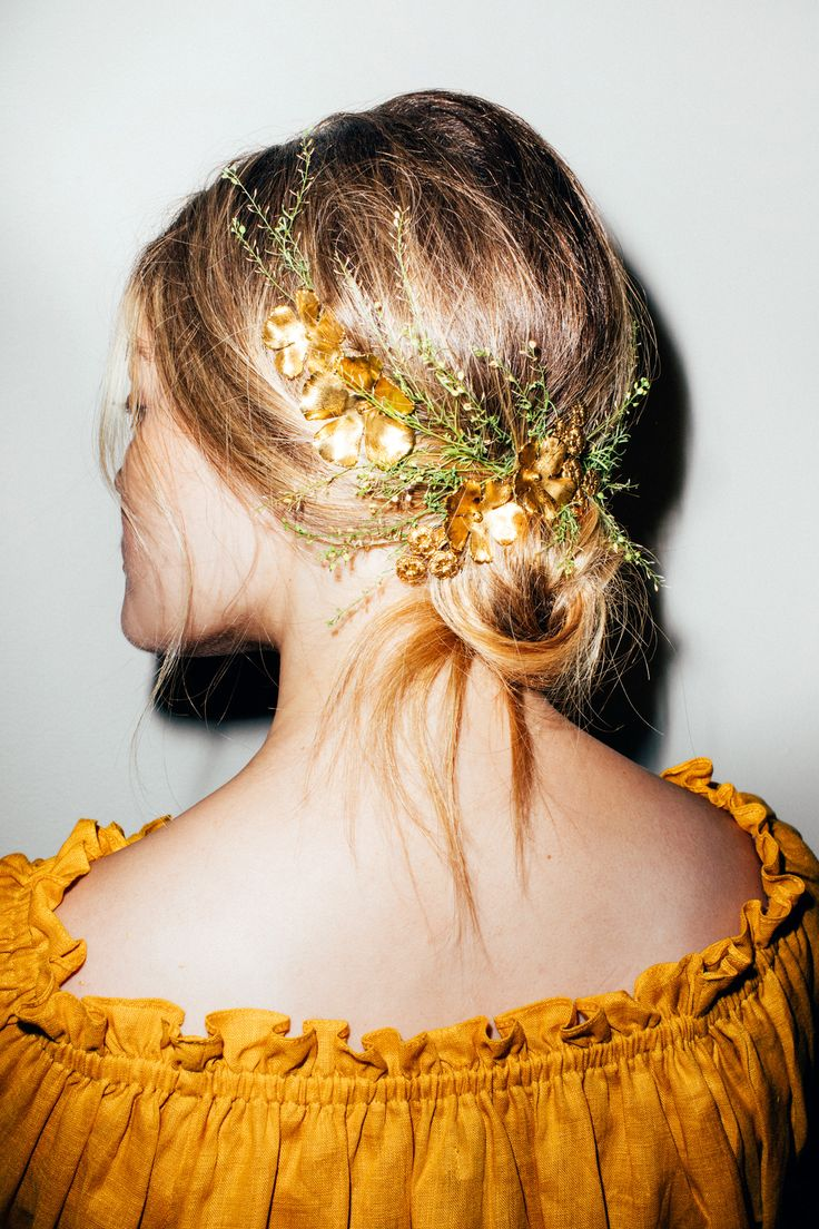 Our Step-by-Step Guide to Styling Hair Accessories: In the summer, we just want to look like we're a pretty French lady casually twirling around in the fields of Provence. And the fastest way to bring mid-summer romance in a simple, breezynightgowntwirlingdress is with a few twists of hair and dreamy hair accessories. -- Gold flower barrettes  |  coveteur.com