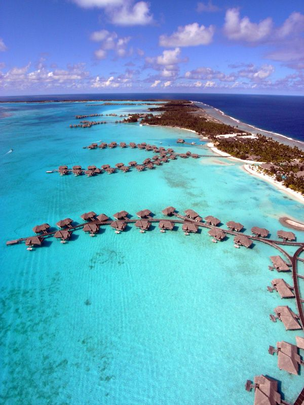 Bora Bora island French Polynesia... If I ever get to go, I want to stay in one of these 'cabins/huts' right over the water!
