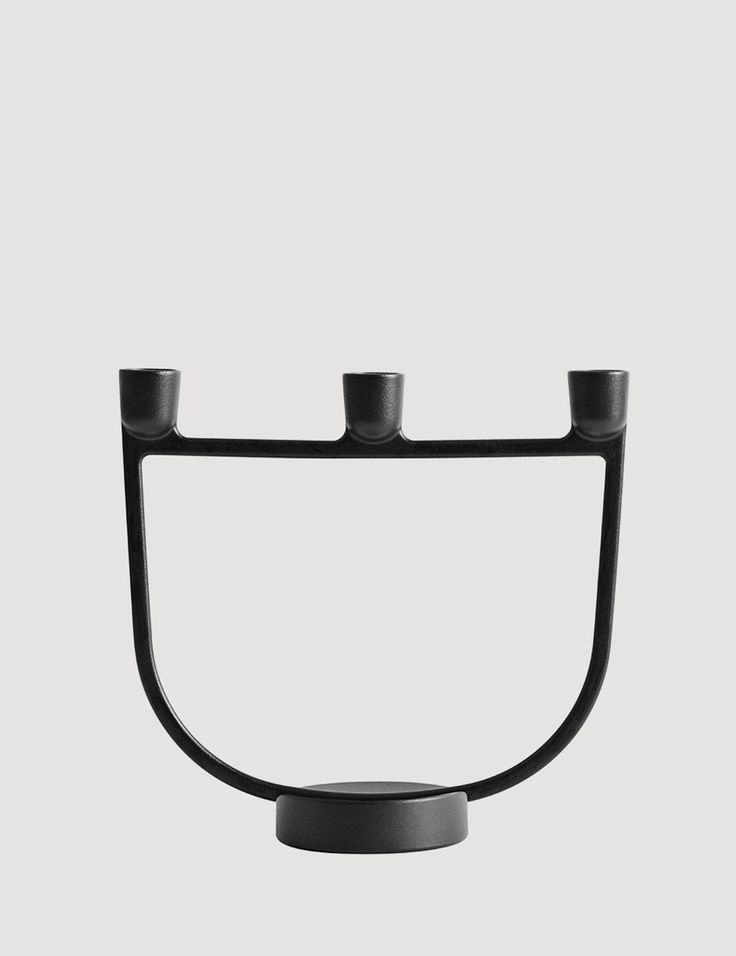 A contemporary candelabra, characterized by its overall shape and graphic details. Light and slender with a stable metal base, ideal for the windowsill or dining table.