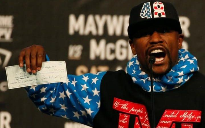 #Mayweather   #McGregor  Mayweatherbrandished a cheque for 100million US dollars at one stage - reportedly his fee for coming out of retirement. The cheque appeared to be the one he earned for his victory over Manny Pacquiao two years ago.