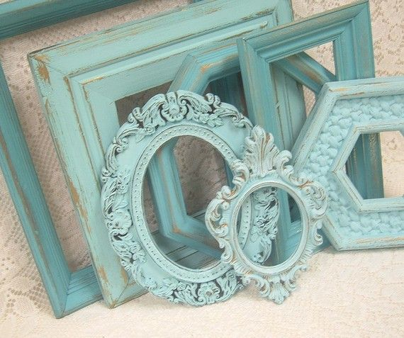 {Painted aqua frames} Collect thrift stores finds.. Paint one color for style uniformity.. AMAZEBALLS!-Stacy
