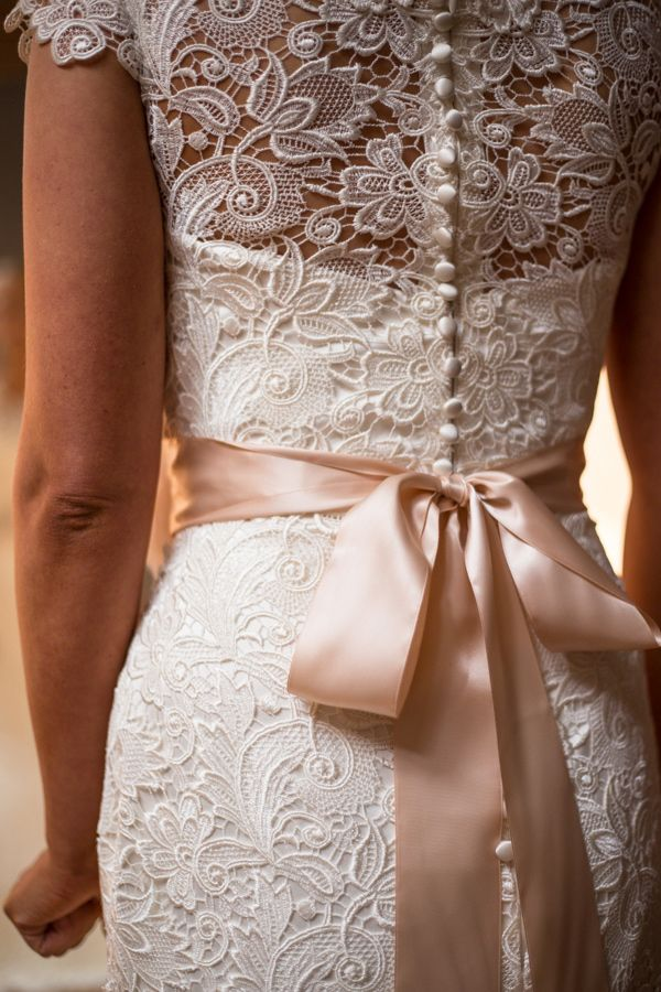 Love this dress, the crochet effect, the blush satin ribbon tied in a bow