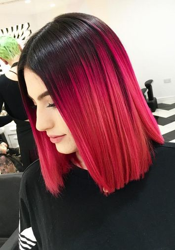 This fiery red-magenta ombré dye job posted on IG account @notanothersalon gives us MAJOR red hair envy! This is definitely a hair look that commands attention.