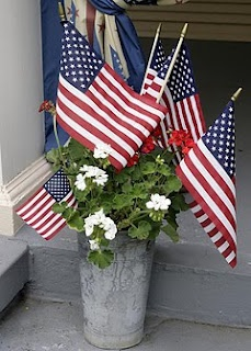 Patriotic galvanized container with flowers.  Add flags for the 4th of July or Veteran's Day.  Simple, yet festive!