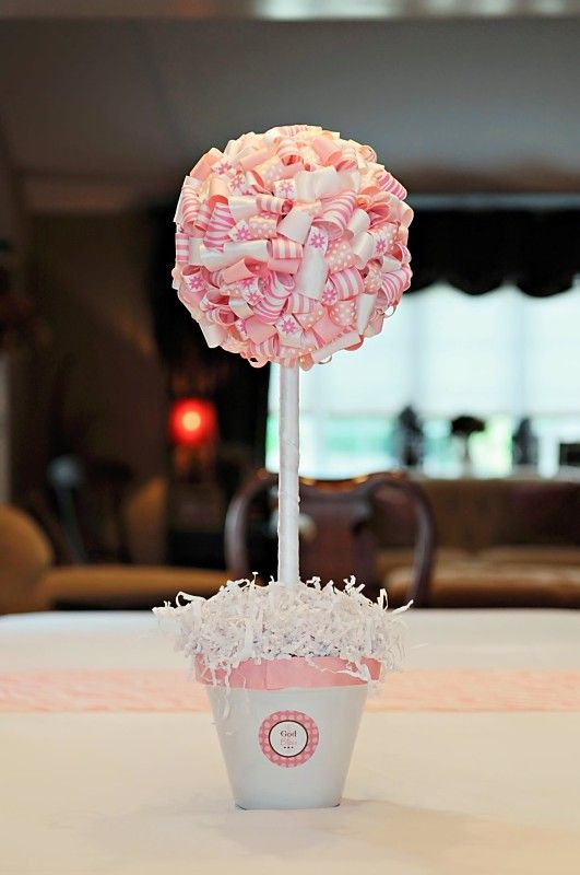 A very cool idea for pink topiary centerpieces via My 2 Pink Ladies!  With two girls this will get used at some point!