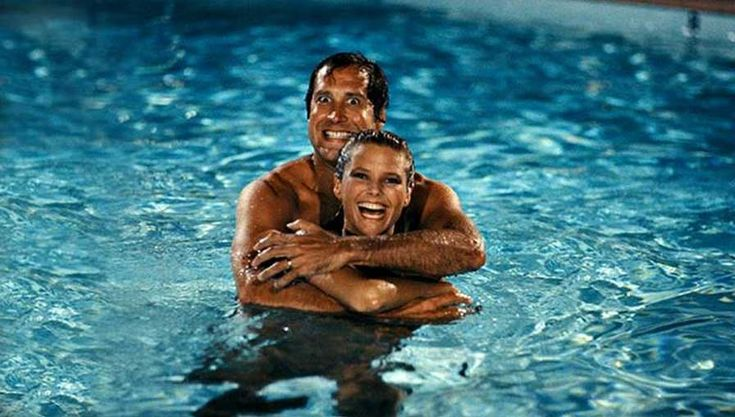 Chevy Chase and Christie Brinkley on the set of National Lampoon's Vacation.