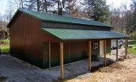 This 30x40x14 brown and green residential pole barn also has a 8x40 open lean-to.