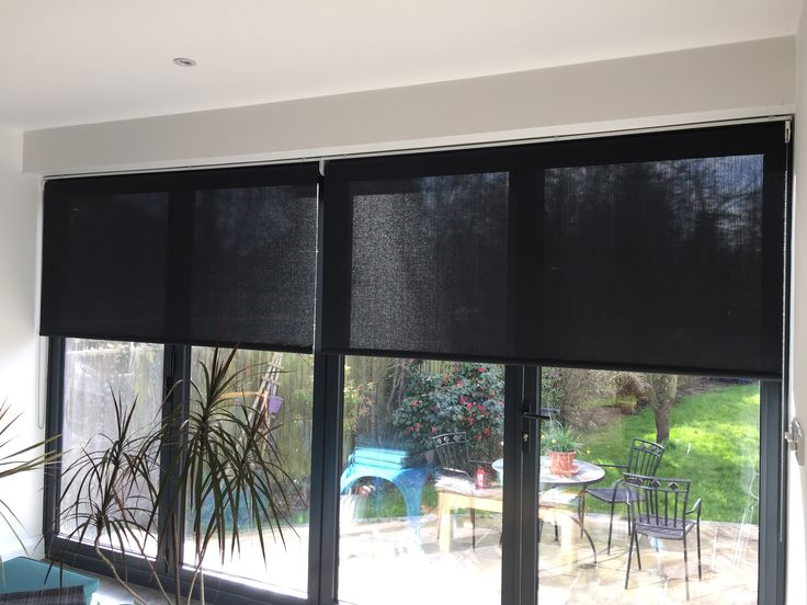 Roller blinds in sunscreen fabric on bifold doors tiny for Door roller blinds