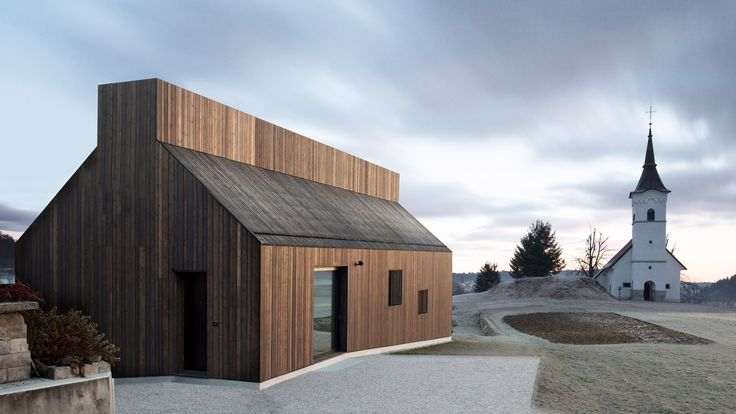 Dekleva Gregorič Arhitekti has extruded the shape of a chimney along the top of this house in Slovenia, creating a continuous roof light and an alternative take on traditional wooden barns.