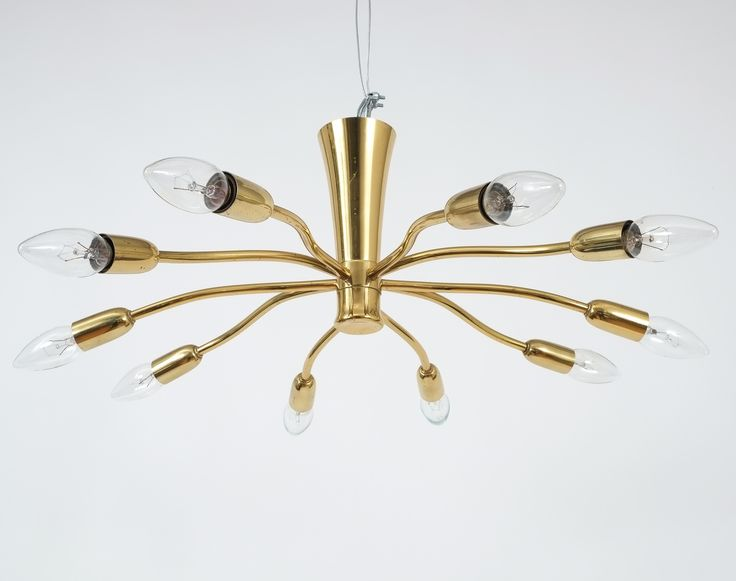 Rare original 'Scorpio' Fixture by J.TKalmar/Austria composed of brench-like split brass tubes with a gorgeous organical handcrafted appeal. Ten bulbs are illuminating this fixture which is in excellent vintage condition. It ranges a bit between chandelier and flush mount. Diameter including bulbs is 26″.