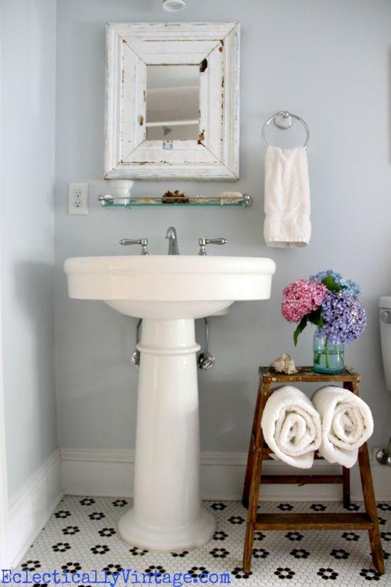 BATHROOM: Shelving idea; take down towel hanger and put up mini shelves? Maybe the IKEA spice racks would work here.