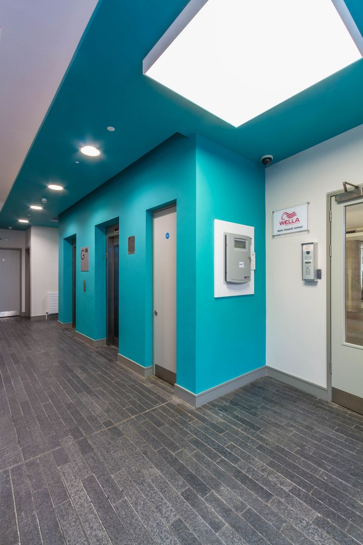 Office Design - Entrance Hall Way - Cyan - Blue - Accent Wall - Office Fit Out - The Chancery Building, Dublin by Think Contemporary