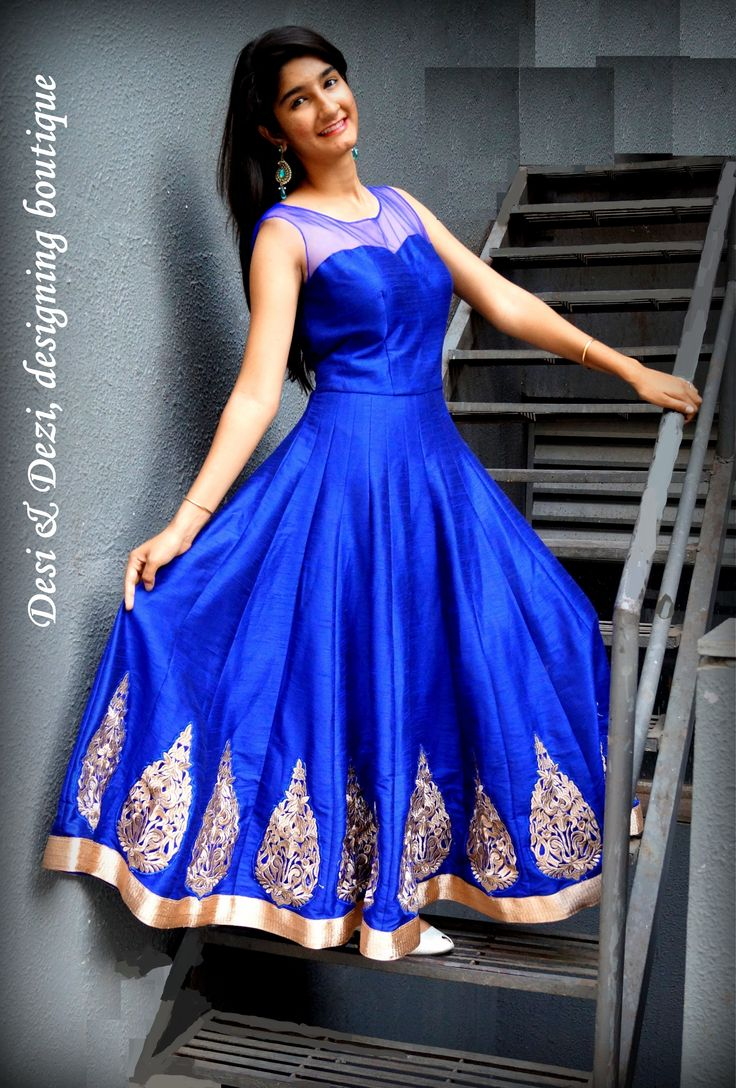 Elegant blue raw silk anarkali with hand engrossed embroidery at the bottom.