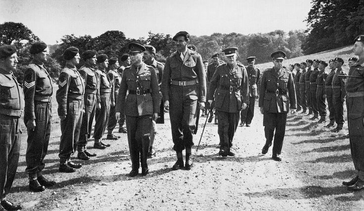 King George and a tall Lord Lovat inspecting Commandos prior to D-Day