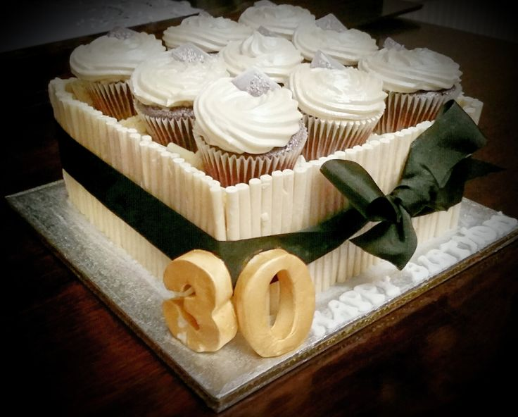 Cupcakes, cigarillos and a large square cake?? Yummy! Order Bespoke or Classic Celebration, Birthday, Christening Cakes