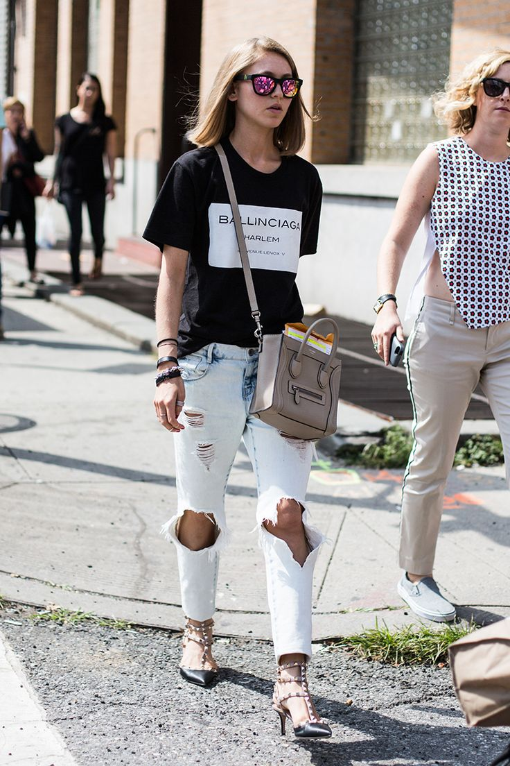 t-shirt, ultra-distressed jeans and statement accessories like mirrored sunglasses, a minibag, and studded heels. Céline bag