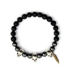Each of these bracelets are individually handmade, containing a selection of Lava Stone beads meticulously combined with an antique gold pewter skull.  Lava Beads, Swarovski™Beads & Antique Pewter Skull Detail Strung on high quality latex free black Powercord® Handmade Bracelet Beautiful minimal design and placement on these bracelets. Easy pull on & pull off function for comfort Sweatshop-Free