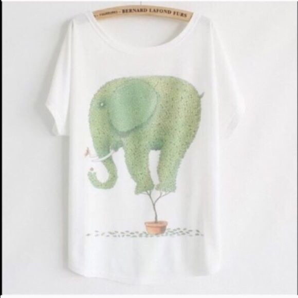 "Animal Print Tee New~Elephant Animal Print Tee New~Elephant Style- Loose Batwing Sleeve Length 25.98"" Bust: 43""-47"" Soft and Comfy Fit~Fabric: 65%Cotton, 35%Polyester Smoke FREE Home No Tradefirm unless bundled Cute Tops Tees - Short Sleeve"