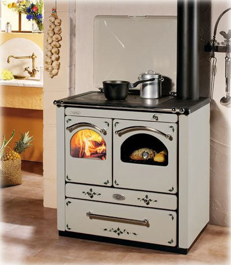 Ambra Decorative The Ambra wood burning cooking stoves offer large hearth and full width, thick hob with the centre of the hob in burnished cast-iron. The handrail and handles are made of steel, while the hearth, front, double doors and smoke circuit ring are made of cast-iron. Cast-iron frame and AISI 304 BA stainless steel oven.