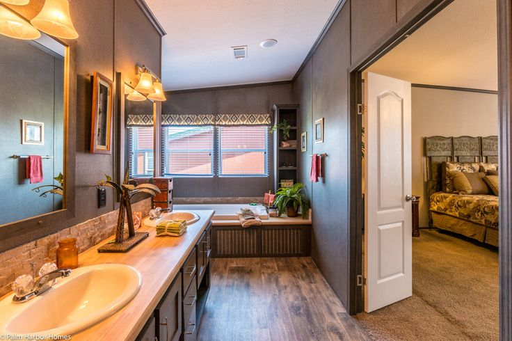 The master bedroom and bathroom are magnificent in the for 6 bedroom double wide