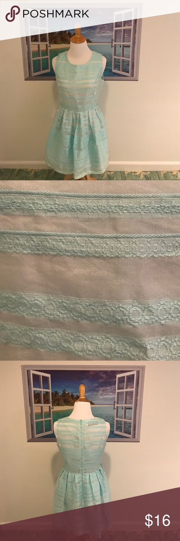 """Lovely Eyelet Dress Simply Lovely Eyelet Dress. Size:MJuniors. Gently used once. EUC. Color is a light blue/ turquoise & like a see thru white almost. Fully lined. Bra friendly. Back zip closure. Pleated detail. Great for a party or event! Length approx 30"""". NO TRADES. yang wen Dresses"""