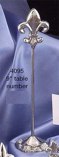 A Silver Fleur De Leis Table Number Holder Adds French Paris Romance To Banquet