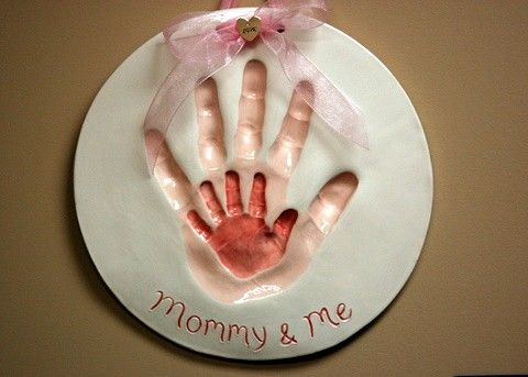 Hand prints of Mommy and me Imprints by Dprintsclayful on Etsy, $93.00 - what a sweet idea but WOW the price. Yikes.