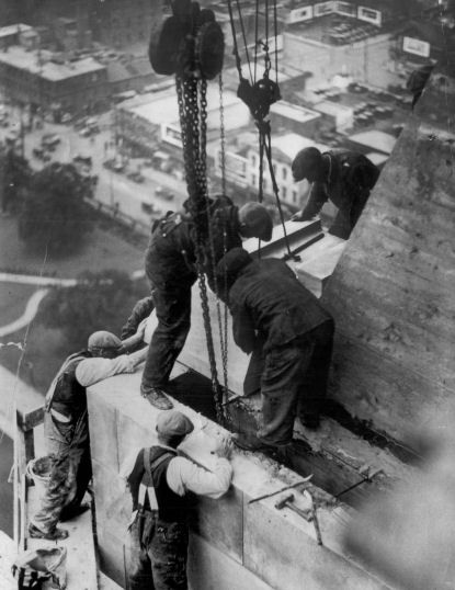 Workmen laying last stone on the Canada Life Building, circa 1930. City of Toronto Archives, Fonds 1244, Item 116.