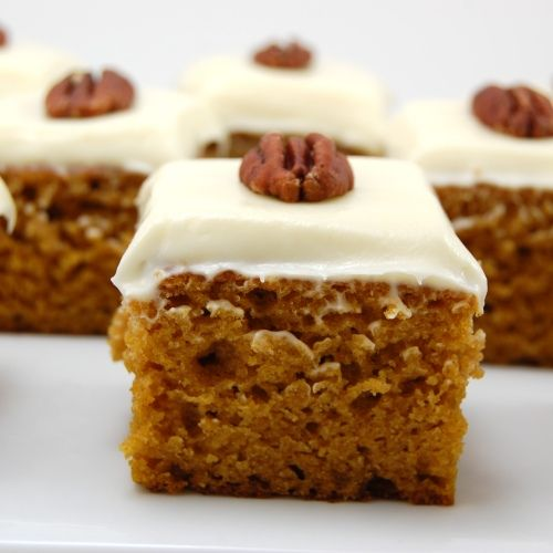 Pumpkin Bars with cream cheese frosting - I made these yesterday and they were a HUGE hit - the bar is tall and moist and dense with flavor while the frosting is light and fluffy and not too sweet!