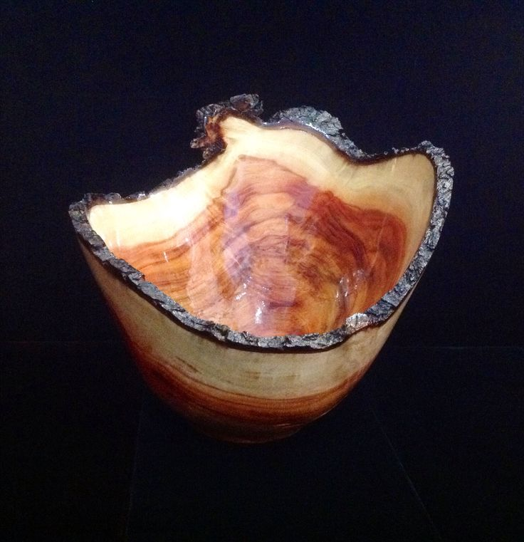 A striking carob wood bowl by local artist, Richard Gould. This bowl has beautiful color and depth.