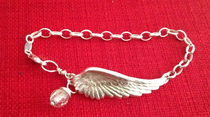Silver belcher chain with angel wing made from silver metal clay and a glow in the dark bead.