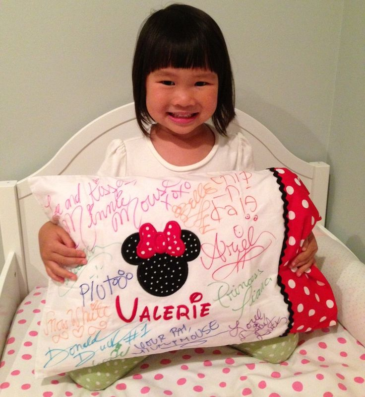 Best Disney Cruise Souvenirs for your little ones- Disney Characters Autographed Pillowcase and photo mat