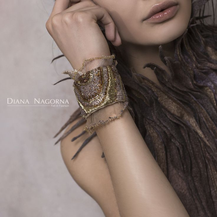 felted bracelet with hand-embroidered beads and gold thread .Author's work of Diana Nagorna