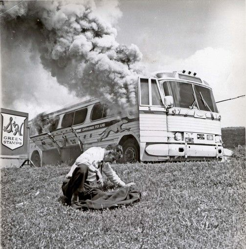 A Greyhound bus that carried Freedom Riders burns after being set ablaze by Ku Klux Klan members in 1961. (Joseph Postiglione / Birmingham)