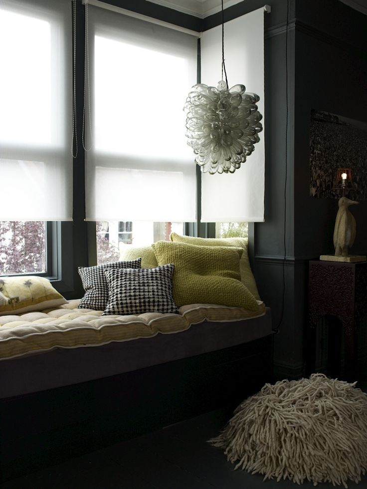 Wow:  the light fixture, the black walls, the crazy pouf.  Nice.