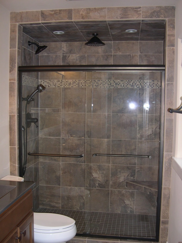 Custom walk in tile shower with glass stone accent stripe for Custom bathroom ideas