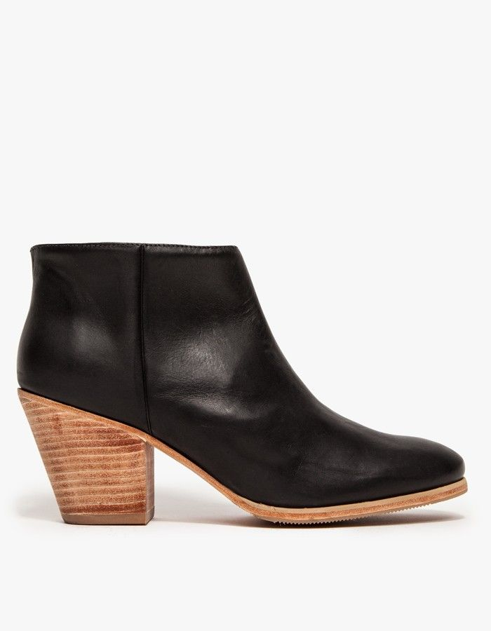 The Rachel Comey Mars Ankle bootie in black or natural leather. Features  pull-on styling, an elastic gore inset and stacked heel.