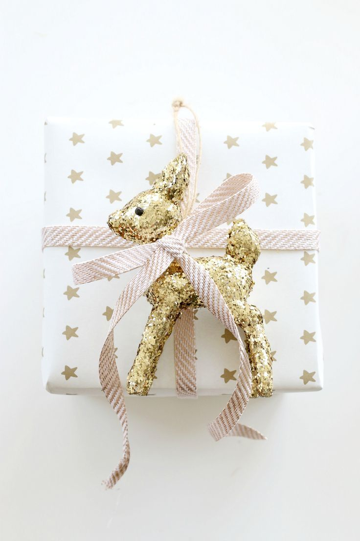 Gift Wrapping With Ribbon And Glittery Fawn