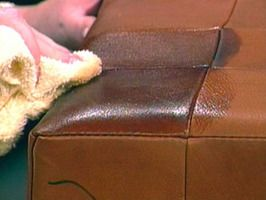 "To nourish the leather, feed it a ""hide food."" Mix one part white vinegar with two parts linseed oil, shake well, and apply to the leather using a soft cloth. Work in a circular motion, covering the entire surface. Rub in thoroughly, let it sit for about 10 minutes, then buff with a soft cloth to bring a shine to the leather surface."