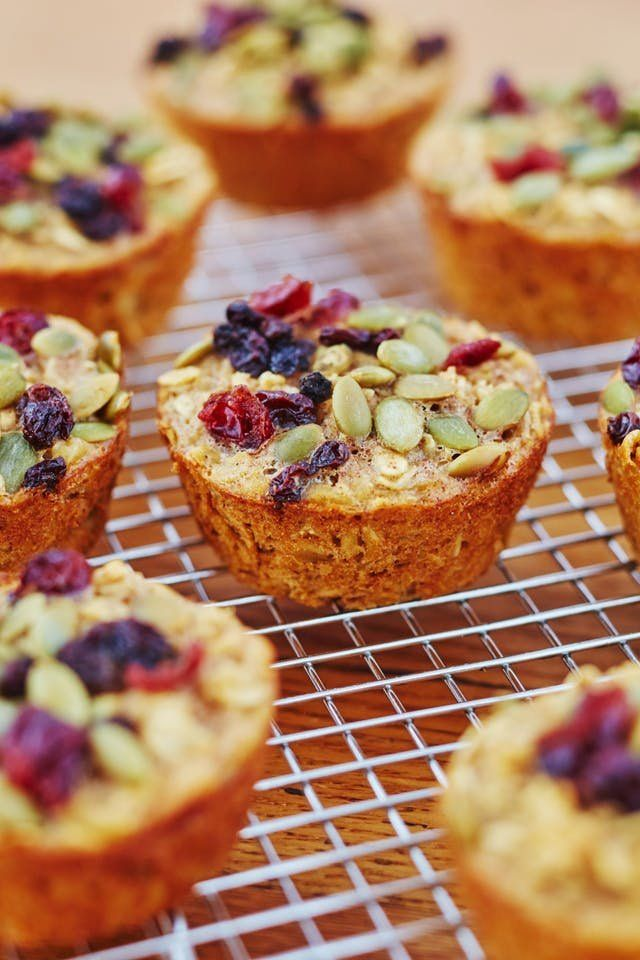 This tutorial shows you how to make tender baked oatmeal cups. They're soft insides are an indication that you can take a bite out of these with no problem. This easy gluten-free recipe is a perfect to-go breakfast when your rushing out of the house in the morning. This healthy protein-filled breakfast (or snack) requires large eggs, milk, unsweetened applesauce,  nut butter, maple syrup or honey, vanilla extract, old-fashioned oats, ground cinnamon and dried fruit.