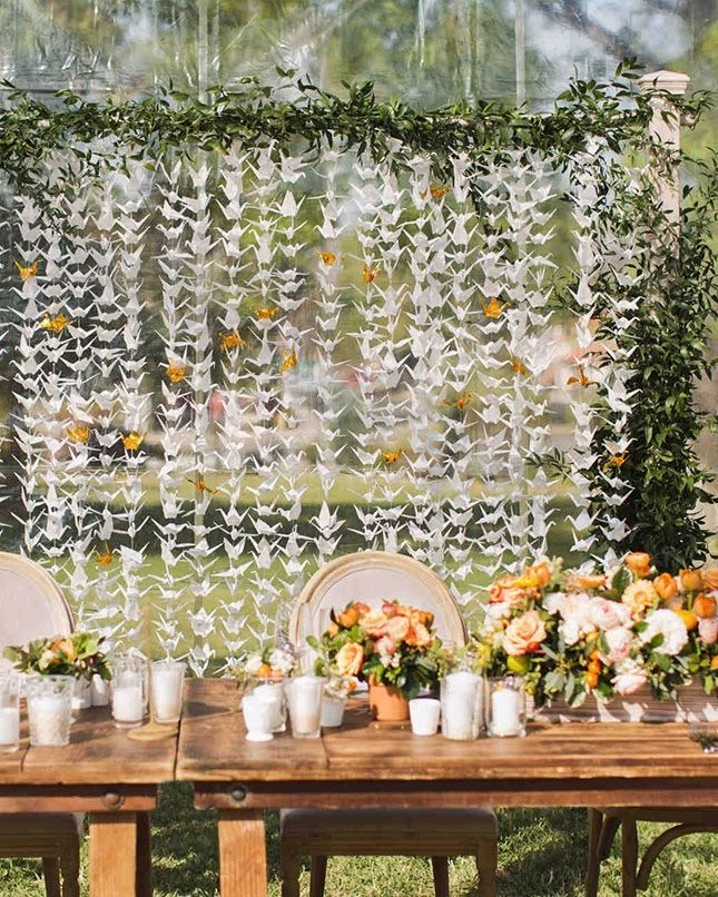 Whimsical + beautiful. This Japanese origami feature wall will inspire on your wedding day.