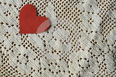 The red heart of paper on a lace background